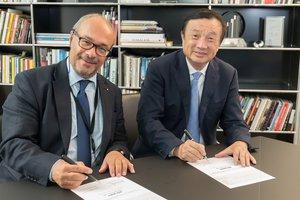 Kaufmann-Zhengfei-Hauwei-signing.jpeg